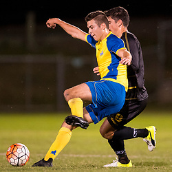 BRISBANE, AUSTRALIA - AUGUST 26: Ethan Docherty of the Strikers and Matthew Capelo of Moreton Bay compete for the ball during the NPL Queensland Senior Men's Semi Final match between Brisbane Strikers and Moreton Bay Jets at Perry Park on August 26, 2017 in Brisbane, Australia. (Photo by Patrick Kearney)