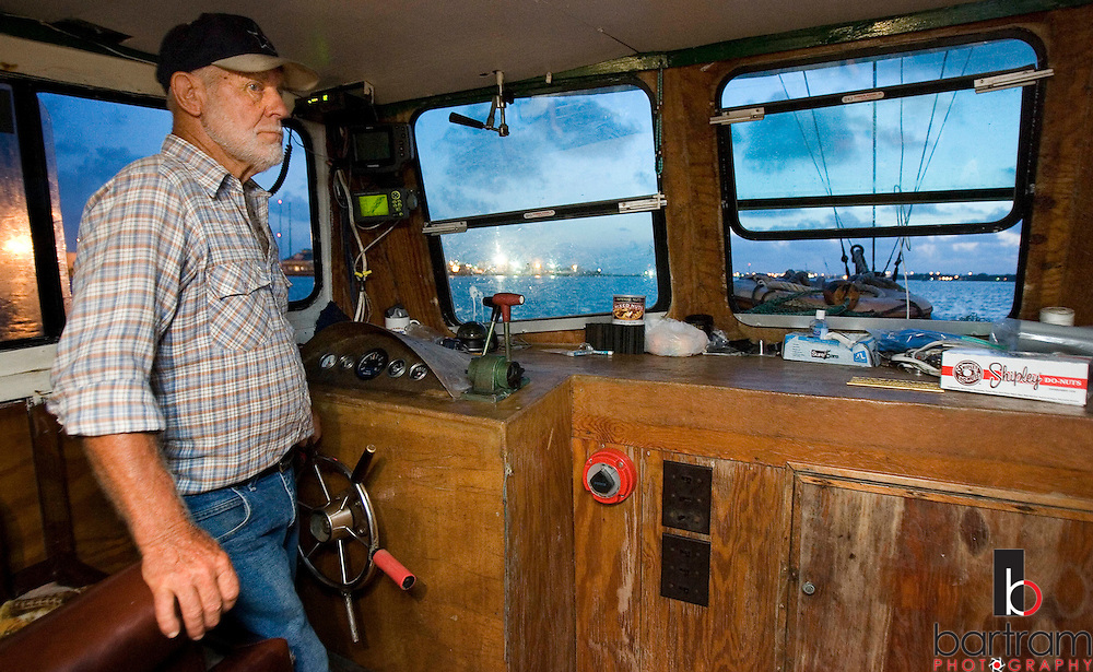 KEVIN BARTRAM/The Daily News.Jerome Kunz guides his shrimp boat St. Vincent away from Pier 19 and into the Galveston Ship Channel as the sun rises on Wednesday, July 12, 2006. Kunz has spent most of his life shrimping around Galveston.