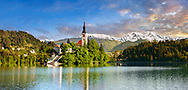 Assumption of Mary Pilgrimage Church island in the middle of  Lake Bled Slovenia at sunset