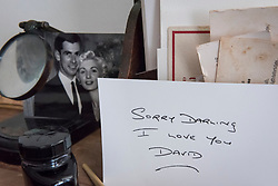 "© Licensed to London News Pictures. 13/11/2018. LONDON, UK. A black and white photograph of David Blakely and Ruth Ellis, together with the last note Blakely wrote to Ellis. Preview of ""Glad I Did It"", a new work by Irish artist Christina Reihill at Bermondsey Project Space.  The interactive artwork looks at the life and death of Ruth Ellis, the last woman to be hanged in Britain, after she shot her lover, racing driver, David Blakely in 1955.  On display are the artist's interpretation of Ruth Ellis' prison cell, including furniture and props, the hanging room together with a video display of the artist in conversation.   The show runs 14 November to 1 December 2018.  Photo credit: Stephen Chung/LNP"