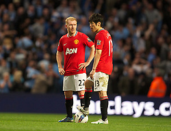 MANCHESTER, ENGLAND - Monday, April 30, 2012: Manchester United's Paul Scholes and Park Ji-Sung looks dejected as they kick-off following Manchester City's first half injury time goal during the Premiership match at the City of Manchester Stadium. (Pic by David Rawcliffe/Propaganda)