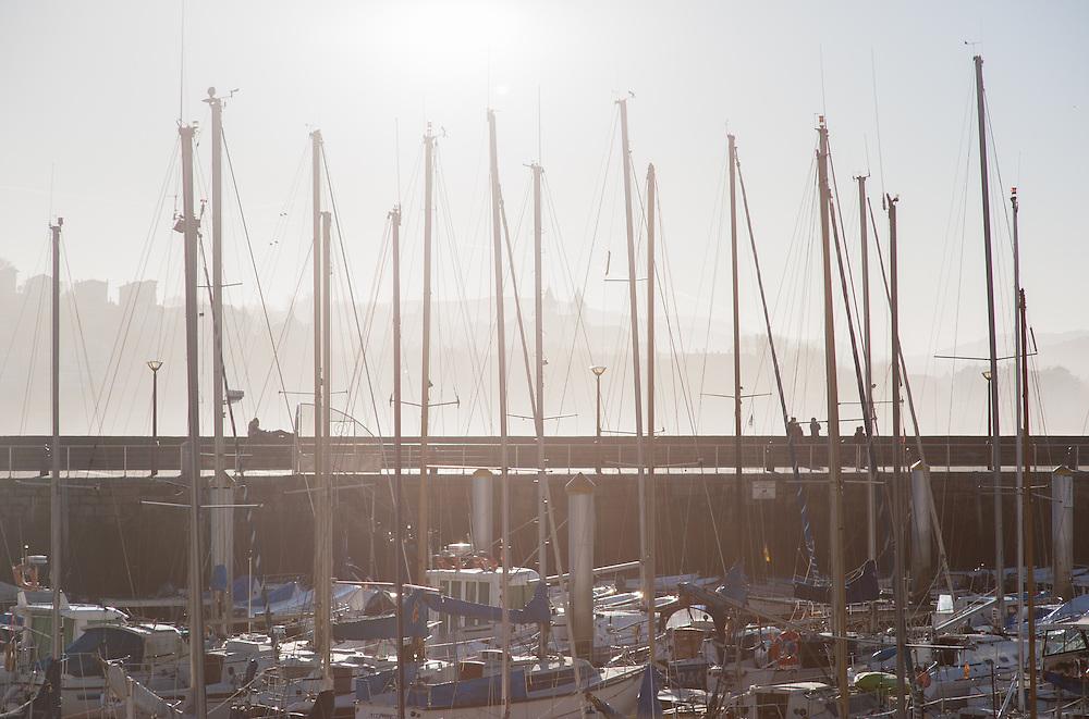 Boat masts in San Sebastian harbor (Spain)