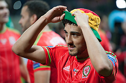 ZENICA, BOSNIA & HERZEGOVINA - Saturday, October 10, 2015: Wales Neil Taylor celebrates after securing a place at next years Euro Championships after the Bosnia & Herzegovina vs Wales match at the Stadion Bilino Polje during the UEFA Euro 2016 qualifying Group B match. (Pic by Peter Powell/Propaganda)