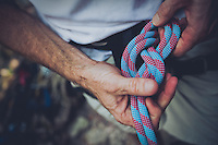 """Sam Dean   The Roanoke Times<br /> 7/8/10--Roanoke Times outdoors editor Mark Taylor ties a """"follow through figure eight"""" knot, the most basic climbing knot, used to attach a climber to his rope."""