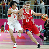 31 July 2012: Russia Dmitry Khvostov brings the ball upcourt against China Ailun Guo during the 73-54 Russia victory over China, during the men's basketball preliminary, at the Basketball Arena, in London, Great Britain.