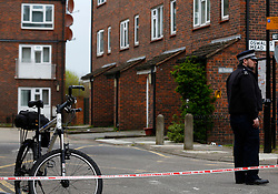 © Licensed to London News Pictures. London, UK. 31/03/2014. Police officers investigate the murder of a mother and her daughter at their home in Oswald Mead, Homerton. They found a 45-year old woman, a 23-month old baby girl and a 53-year old man suffering from injuries this morning (31/03/14). The man was taken to a hospital in east London and has been arrested on suspicion of murder. Photo credit: LNP