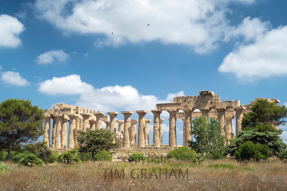 In the landscape, ruins of ancient temples at Selinunte in Sicily, Italy - the largest archeological park in Europe.