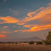 Lenticular clouds glow in a sunset over pastures in Montana's Gallatin Valley, near Bozeman.