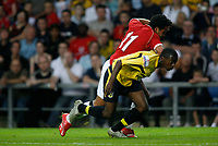 Photo: Marc Atkins.<br />Oxford United v Manchester United XI. Pre Season Friendly. 08/08/2006. Manchester United's Kieran Richardson battles with Oxford's Eddie Anaclet (R)