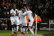 Jordan Ayew of Swansea city © celebrates with his teammates Tom Carroll ® &Tammy Abraham (l) after he scores his teams 1st goal to make it 1-1.   Premier league match, Swansea city v Crystal Palace at the Liberty Stadium in Swansea, South Wales on Saturday 23rd December 2017.<br /> pic by  Andrew Orchard, Andrew Orchard sports photography.