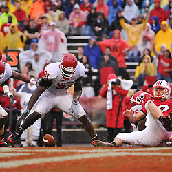 Sep 26, 2009; College Park, MD, USA; Rutgers defensive end George Johnson (31) recovers a ball stripped by cornerback Joe Lefeged (26) from Maryland quarterback Chris Turner (10) for a touchdown during the second half of Rutgers' 34-13 victory over Maryland in NCAA college football at Byrd Stadium.