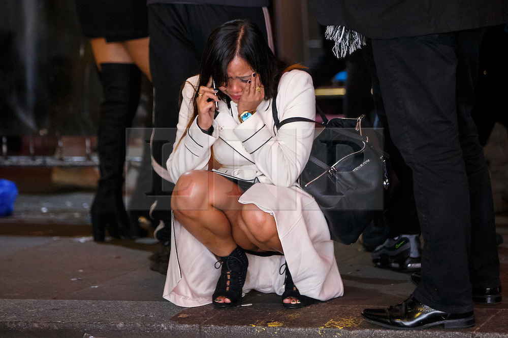 © Licensed to London News Pictures. 01/01/2017. London, UK. An intoxicated reveller cries as people celebrate the New Year in central London during the first hours of 2017 on January 1. Photo credit: Tolga Akmen/LNP
