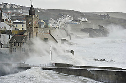 © Licensed to London News Pictures. Date 08/02/2014. Porthleven, UK. Storm waves hit the sea wall at Porthleven, Cornwall. Gales of up to 80mph and 35 feet waves are expected to hit parts of the West coast. Photo credit : Mark Hemsworth/LNP