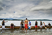 David Williams, of Bellingham's Autumn Rose Canoe Club, gives directions to his fellow teammates (l-r) Tyson Oreiro, David Oreiro, Ivan Washington, Lawrence Solomom, Justin Williams, Victor Harry and Richard Ballew as they prepare their war canoe to race in the 11-men category at the 61st Annual Lummi Stommish Water Festival at the Lummi Indian Reservation, Washington on June 24, 2007. The team finished first in the race.