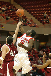 19 November 2005: John LaBad fouls Greg Dilligard as Dilligard takes a shot in a non-conference race that came down to a photo finish. The Illinois State Redbirds slipped past the Indianapolis University Greyhounds 54-50 at Redbird Arena in Normal Illinois