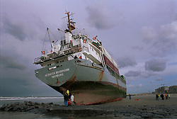 """The German cargo ship """"Heinrich Behrmann"""", was run-aground by heavy seas, after losing power to her main engine, on the beach in Blankenberge, Belgium. The ship was heading for the port at Zeebrugge from Ireland, and was carrying dry cargo, none of which was hazardous. The salvage company Unie Van Redding - En Sleepdienst N.V. was hired to free the ship. Three unsuccessful attempts were made, the second attempt resulted in the injury of two workers when tug boat cables snapped. (Photo © Jock Fistick)"""