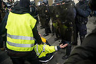 Protesters confronting the police. More than 125000 gathered in Paris for the Gilets Jaune (Yellow vest) protest. Soon the protest turned violent an protesters clashed with the police, tear gas and flash bombs were fired, many injured and arrested by the police. Paris December 6th 2018. Federico Scoppa
