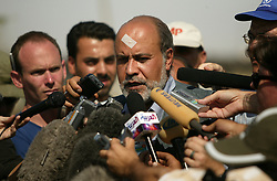 Ramiro Lopes da Silva, center with white bandage, the UN humanitarian coordinator for Iraq, addresses the media at the site of UN in Baghdad, Iraq on Aug. 21, 2003. Earlier in the week a cement truck packed with explosives detonated outside the offices of the UN headquarters in Baghdad, Iraq, killing 20 people and devastating the facility in an unprecedented suicide attack against the world body. At least 100 people were wounded.