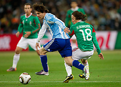Lionel Messi of Argentina vs Andres Guardado of Mexico during the 2010 FIFA World Cup South Africa Round of Sixteen match between Argentina and Mexico at Soccer City Stadium on June 27, 2010 in Johannesburg, South Africa. Argentina defeated Mexico 3-1 and qualified for quarterfinals. (Photo by Vid Ponikvar / Sportida)
