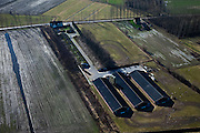 Nederland, Noord-Brabant, Gemeente Sint-Oedenrode, 07-03-2010; intensieve veeteelt in het buitengebied tussen Sint-Oedenrode en Son en Breugel, dal van de Dommel. De velden rond de boerderijen worden gebruikt voor het injecteren van mest.Intensive farming in the countryside between St Oedenrode and Son en Breugel, the Dommel valley.  The fields around the farmhousers are used to inject manure.luchtfoto (toeslag), aerial photo (additional fee required);.foto/photo Siebe Swart