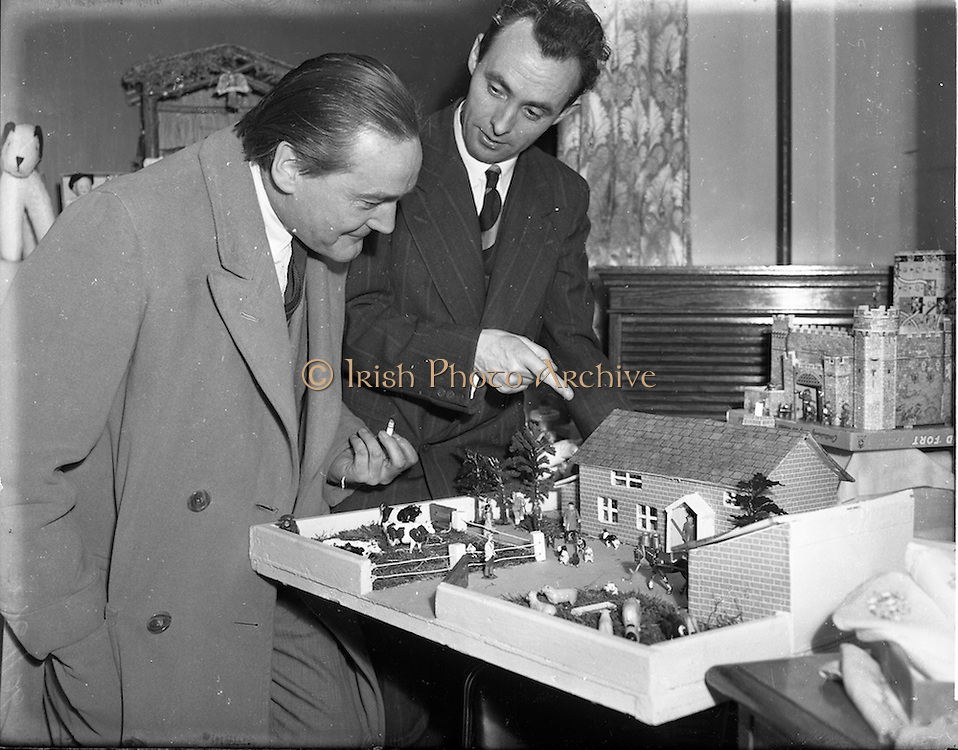 10/11/1952<br /> 11/10/1952<br /> 10 November 1952<br /> Franciscan toy competition at the Franciscan Friary, Merchants Quay, Dublin. Michael Scott, architect on left, showing an interest in a toy house and farmyard.