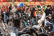 A leather clad biker cruises down Main Street during the 74th Annual Daytona Bike Week March 8, 2015 in Daytona Beach, Florida. More than 500,000 bikers and spectators gather for the week long event, the largest motorcycle rally in America.