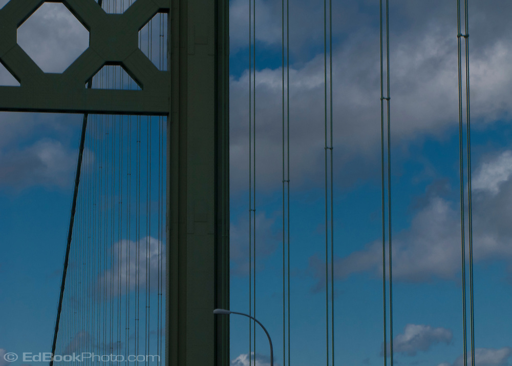 looking up at the Tacoma Narrows bridge tower and cables across the Tacoma Narrows of southern Puget Sound in western Washington state, USA