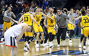 ANDREW SHURTLEFF/THE DAILY PROGRESS<br /> Virginia guard Kyle Guy (5) reacts after loosing to UMBC 74-54 in the first round of the NCAA Tournament Friday in Charlotte.