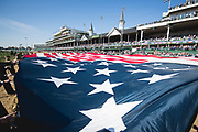 November 3, 2018: A large American flag is spread out over the track at Churchill Downs.