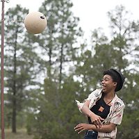 Orchid Wilson plays a game of tetherball at Camp Kiwanis in Wanderwagon Saturday. Wilson was participating in the Northwest New Mexico Pride Gathering hosted at the camp.