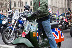 London, UK. 12th April 2019. Thousands of bikers ride through Parliament Square as part of a Rolling Thunder Ride for Soldier F organised by Harry Wragg and other armed forces veterans in support of the 77-year-old former soldier known as Soldier F who is to be prosecuted for the murders of James Wray and William McKinney at a civil rights march in Londonderry on Bloody Sunday in 1972.
