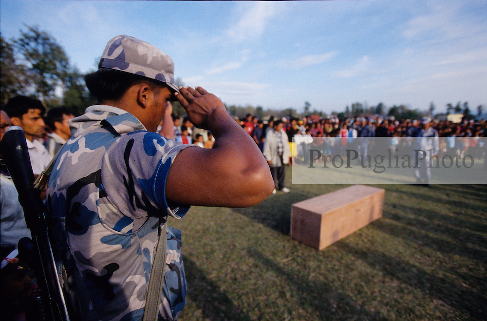 """Surket, 01 March 2005... Policemen paying tribute to their colleague killed by Maoists the previous day. """"Our King Gyanendra is not the Rome's Emperor Nerone. He can't just sit in Kathmandu and watch Nepal burning... The Maoist principles are good, but the ways they threat people are wrong. They should act legally as a political party. We want peace, not war.."""" a police officer says"""