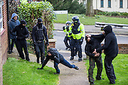 Police try to stop fights breaking out as two opposing groups meet on a local Dover estate as Anti Facist demonstrators march through Dover protesting against a facist demonstration also taking place in the port town. 30th January 2016