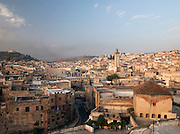 View of the medina including the Kairaouine Mosque at dawn in Fes, Morocco