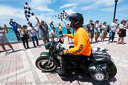 Pat Patterson riding his 1946 Harley-Davidson Flathead over the finish line after the Cross Country Chase motorcycle endurance run from Sault Sainte Marie, MI to Key West, FL. (for vintage bikes from 1930-1948). The Grand Finish in Key West's Mallory Square after the 110 mile Stage-10 ride from Miami to Key West, FL and after covering 2,368 miles of the Cross Country Chase. Sunday, September 15, 2019. Photography ©2019 Michael Lichter.
