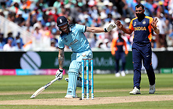 England's Ben Stokes makes it to the crease as bowler India's Mohammed Shami looks on during the ICC Cricket World Cup group stage match at Edgbaston, Birmingham.