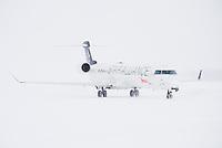 Air Canada Jazz CRJ-705 in snowstorm