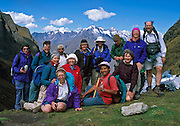Our trekking group poses on Dead Woman's Pass (13,770 feet elevation) on the Inca Trail, Cordillera Vilcabamba, Andes mountains, Peru, South America. Published in September/October 2007 and in March/April 2001 Sierra Magazine, Sierra Club Outings. For licensing options, please inquire.