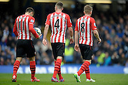 Dusan Tadic of Southampton, Morgan Schneiderlin of Southampton and Steven Davis of Southampton walk towards the penalty spot. Barclays Premier league match, Chelsea v Southampton at Stamford Bridge in London on Sunday 15th March 2015.<br /> pic by John Patrick Fletcher, Andrew Orchard sports photography.