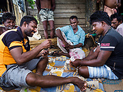 07 OCTOBER 2017 - MORATUWA, SRI LANKA: Fisherman play cards while they relax in Moratuwa, a fishing village south of Colombo. Fish is an important source for many Sri Lankans.  PHOTO BY JACK KURTZ