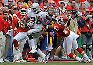 Running back Darren McFadden (20) of the Oakland Raiders stiff arms safety Jarrad Page (44) of the Kansas City Chiefs, as McFadden rushes for a first down in the third quarter at Arrowhead Stadium in Kansas City, Missouri on September 14, 2008.....