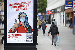 © Licensed to London News Pictures. 25/05/2021. London, UK. A billboard in the Hight Street in Hounslow, west London urges people to get surge tested. The government have advised against travel in eight areas in England, including the London borough of Housnlow, because of the rising number of Covid-19 infections due to the Indian variant of the disease. Photo credit: Peter Macdiarmid/LNP