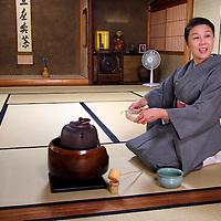Asia, Japan, Kyoto. Hostess prepares to serve tea.