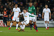 Roque Mesa of Swansea city plays the ball ahead of Salomon Rondon of West Bromwich Albion.  Premier league match, Swansea city v West Bromwich Albion at the Liberty Stadium in Swansea, South Wales on Saturday 9th December 2017.<br /> pic by  Andrew Orchard, Andrew Orchard sports photography.