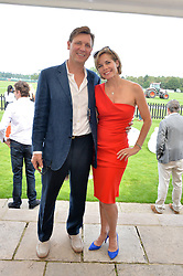 DARCEY BUSSELL and ANGUS FORBES at the Audi International Polo at Guards Polo Club, Windsor Great Park, Egham, Surrey on 26th July 2014.