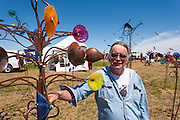 Don Pell, Wingnut Enterprizes, Bellevue, Saskatchewan, and one of his kinetic wind sculptures. Windscape Kite Festival, Swift Current, Saskatchewan.