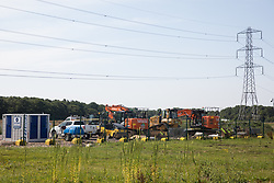 Harefield, UK. 26 June, 2020. HS2 machinery and equipment in a compound in the Colne Valley.