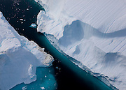 Space between two icebergs, Sermilik Fjord, East Greenland, from a helicopter