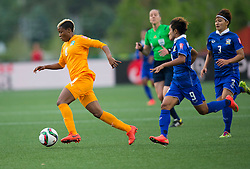12.06.2015, Lansdowne Stadium, Ottawa, CAN, FIFA WM, Frauen, Elfenbeinküste vs Thailand, Gruppe B, im Bild Ines Nrehy (L) of Cote d'Ivoire drives the bal. Cote d'Ivoire lost the match 2-3 // during group B match of FIFA Women's World Cup between Ivoire Coast and Thailand at the Lansdowne Stadium in Ottawa, Canada on 2015/06/12. EXPA Pictures © 2015, PhotoCredit: EXPA/ Photoshot/ Zou Zheng<br /> <br /> *****ATTENTION - for AUT, SLO, CRO, SRB, BIH, MAZ only*****