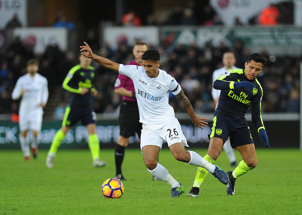 Swansea City's Kyle Naughton vies for possession with Arsenal's Alexis Sanchez<br /> <br /> Photographer /Ashley Crowden CameraSport<br /> <br /> The Premier League - Swansea City v Arsenal  - Saturday 14th January 2017 - Liberty Stadium - Swansea <br /> <br /> World Copyright © 2017 CameraSport. All rights reserved. 43 Linden Ave. Countesthorpe. Leicester. England. LE8 5PG - Tel: +44 (0) 116 277 4147 - admin@camerasport.com - www.camerasport.com